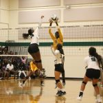 Lady Bulldogs take a bite out of the Everman Bulldogs, sweeping them out of their gym Tuesday night in three games. Pictures of the games included.