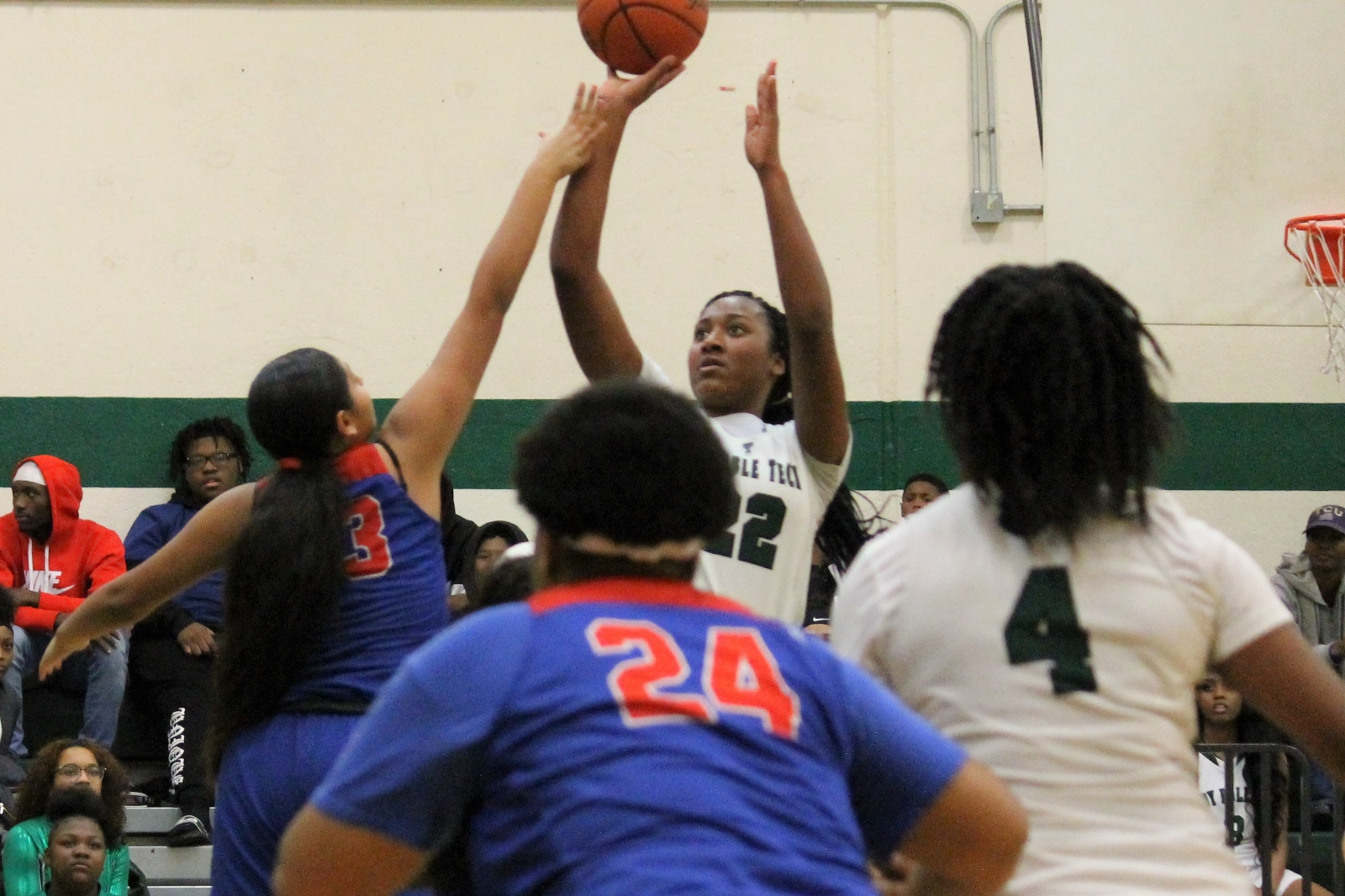 Trimble Tech basketball teams host Arlington Sam Houston and split (pictures included), schedule for holiday break.