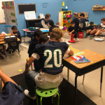 Football Team Reads To KU Students