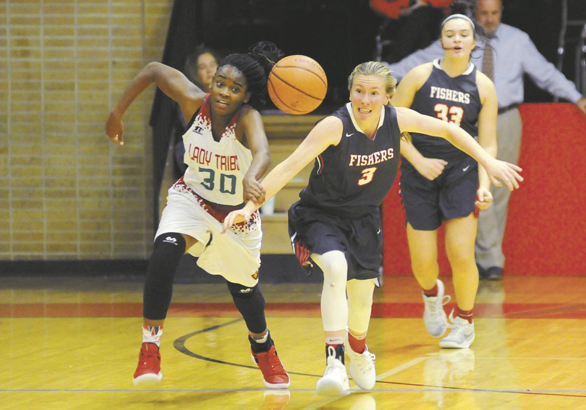 Lady Tribe falls short in home opener