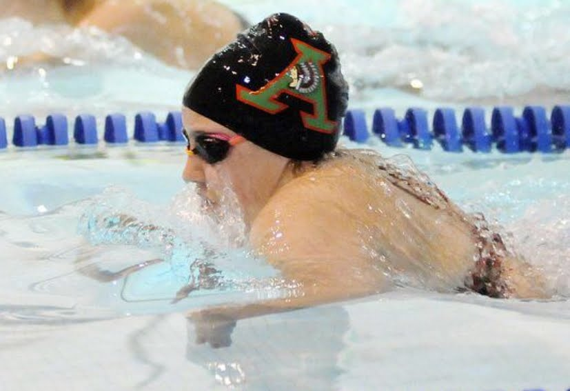 Boys swim past Tigers; Girls win 9 of 12 events