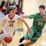 Warren Nets 1,000 in Tigers Win