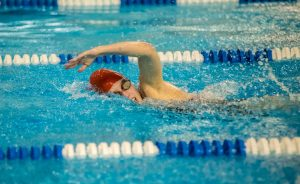 A Westerville South swimmer swims freestyle