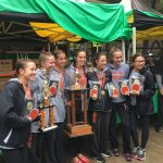 cross country girls with trophies