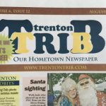 Boys and Girls Swim hand out Trenton Trib to the Community.