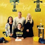 Cheerleader signs with Adrian College!