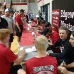 Players sign autographs