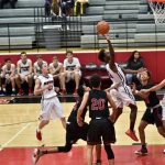 Heritage boys basketball makes statement in district opener
