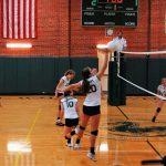 Player Hitting Ball Over Net