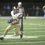 Buzalka finds the end zone, Football falls to Trinity