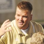 ESTES -NAMED DISTRICT COACH OF YEAR