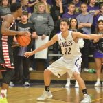 CHS boys' varsity basketball team battles TC