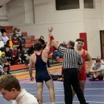 Wrestling Team Splits With Top Conference Schools