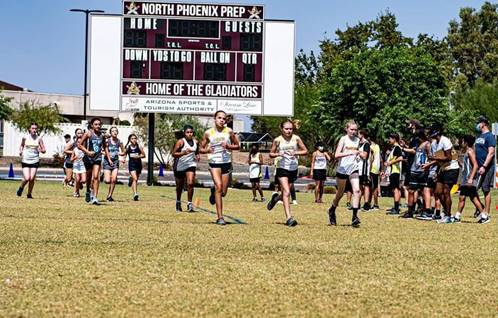 cross country team running race across the field.