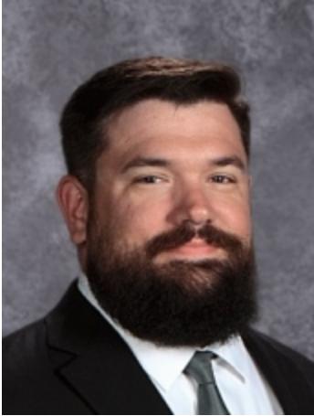 Josh Adkins named new Green Wave Wrestling Coach