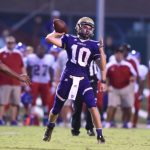 Payne throws for 4 TDs to lead Purples past Christian Co