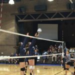Volleyball player hitting the ball.