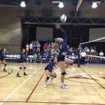Volleyball player jumping to hit the ball.