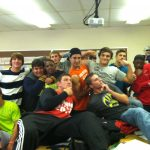 The Varsity Football team in Study Hall before practice