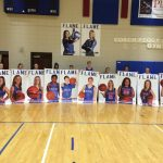 Senior Basketball Players with their Banners
