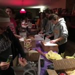 Softball Players Create Care Packages for Troops
