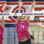 VOLLEYBALL DIGS PINK BUT FALLS SHORT OF VICTORY
