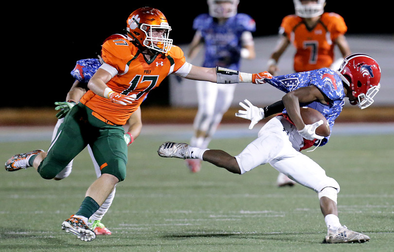 POLY SLIPS BY KING IN RIVALRY GAME