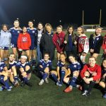 GIRLS WEATHER A NORCO STORM, STAND VICTORIOUS
