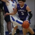 Revere Hosts Magics in Suburban League Boys' Basketball