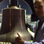 Peter Kraft Rings the Victory Bell at the Gridiron Classic