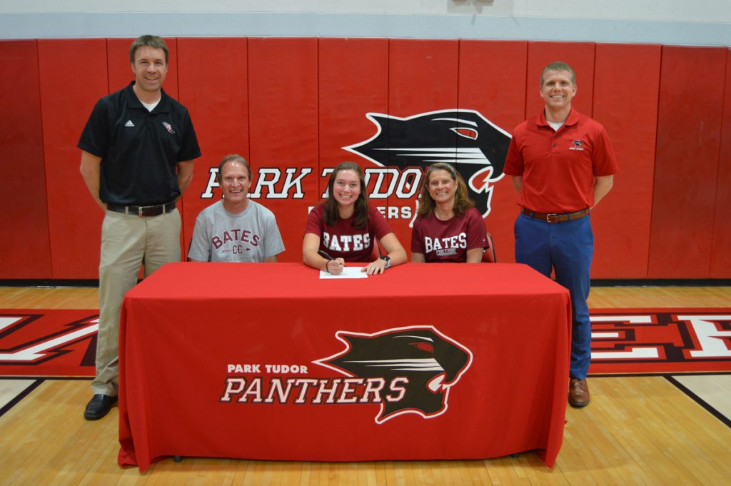 Jenna Beagle with her parents and coaches