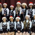 Varsity and JV Cheerleaders Perform a Christmas Dance At Game