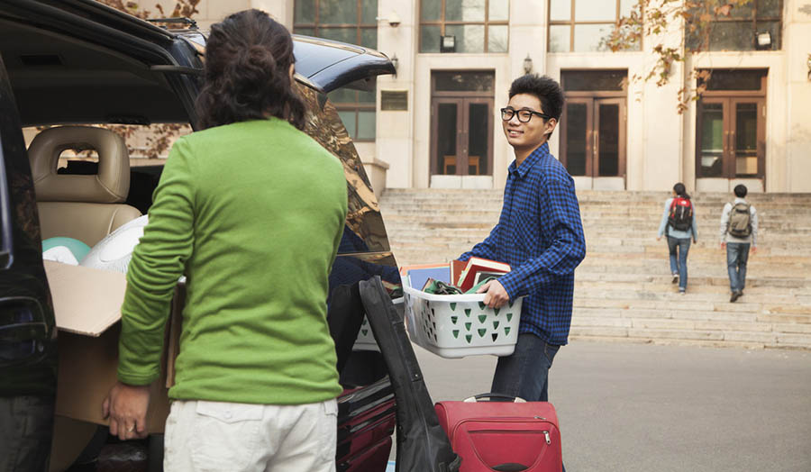 Mother helping student move into university campus