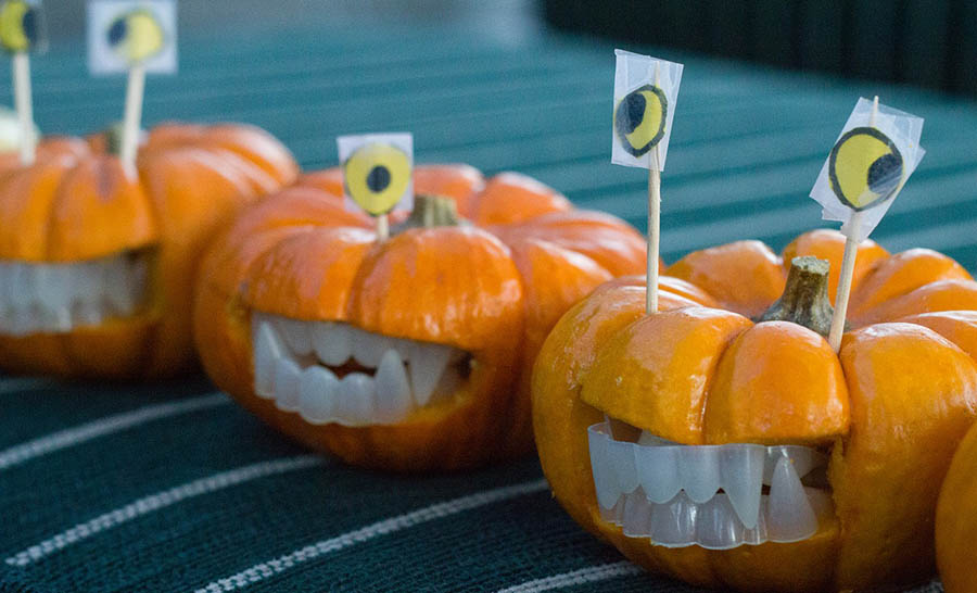 Decorated mini pumpkins with teeth and eyes