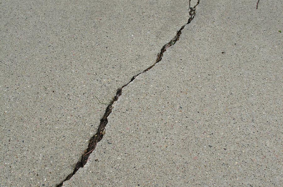 Spring cleaning your home s exterior for Bleaching concrete driveway