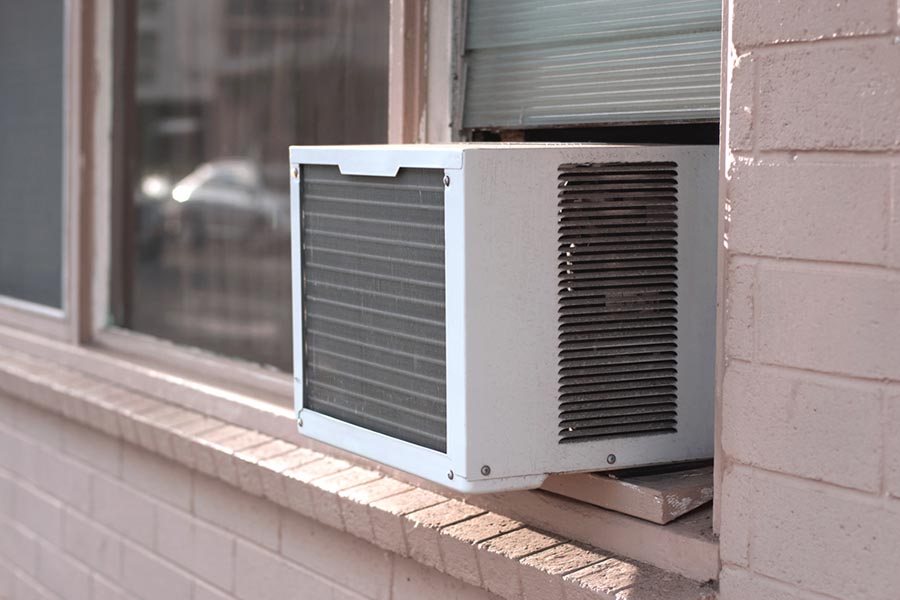 Window air conditioner installed in a brick building