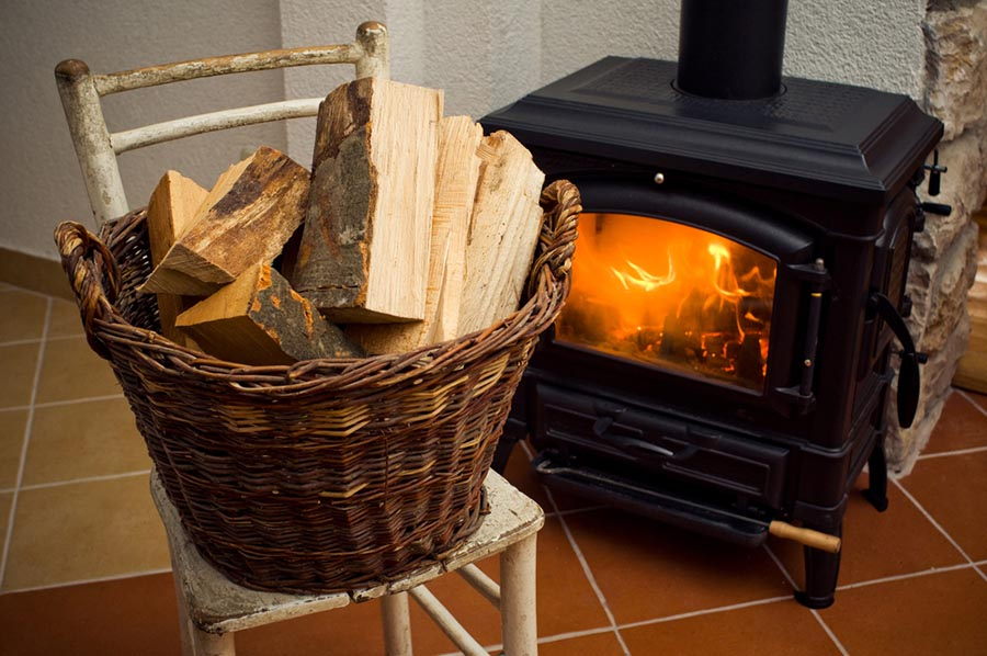Pile of chopped wood beside a wood burning stove