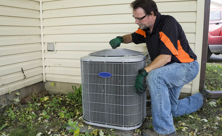 Man reviews outdoor HVAC system