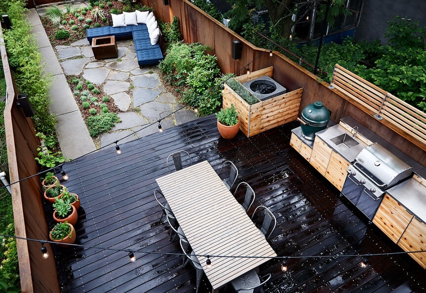 Overview of a backyard kitchen with seating area