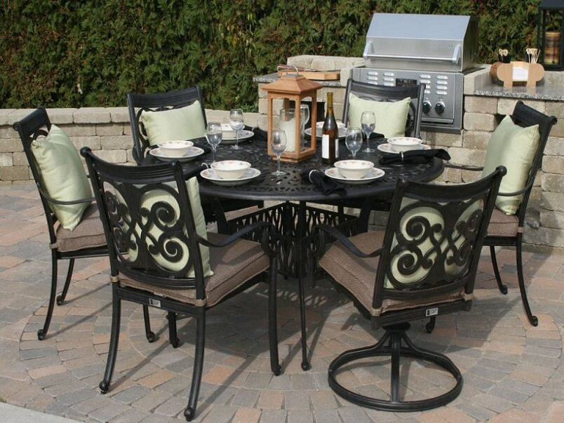 round aluminum table for an outdoor seating area