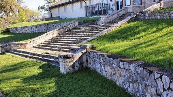 Long stone retaining wall outside a house