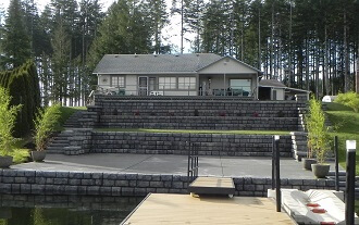 Large detached house with two retaining walls in the front