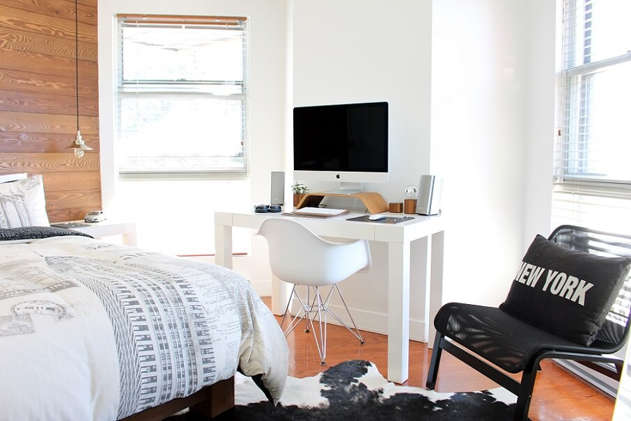 bright office bedroom with small desk and bed