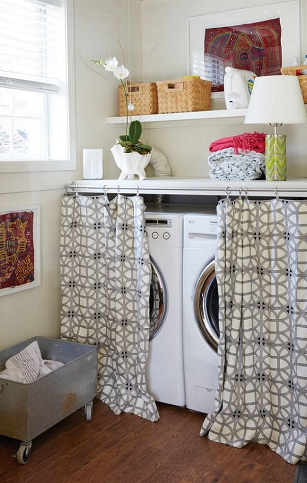 Washer and dryer hidden behind curtain in room