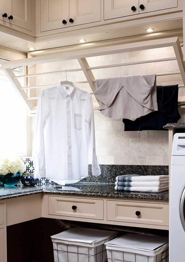 Hanging clothes in the laundry room