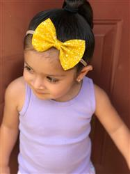 Aimee L. verified customer review of Yellow statement bow