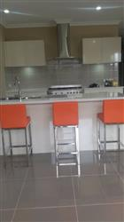 Therese Polished Stainless Steel Leg Bar Stool 68cm Orange