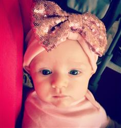 Jenna S. verified customer review of Copper & Coral Sparkle Bow Headwrap