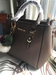 Paula Millsap verified customer review of Elegant Leather Handbag With Pompoms