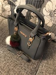 Phoebe Vincent verified customer review of Elegant Leather Handbag With Pompoms